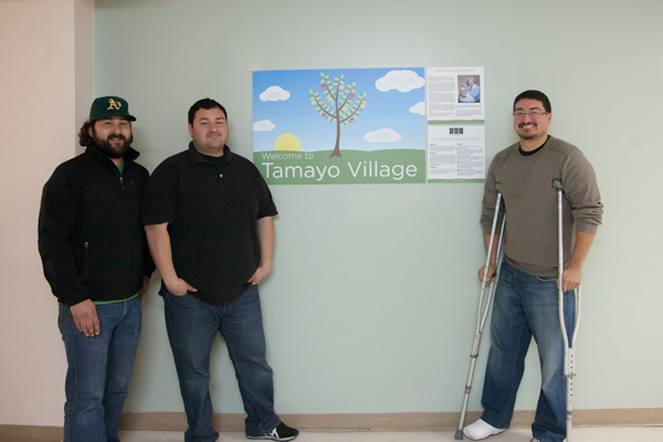 Members of the Tamayo Family Stand in Front of the New Sign
